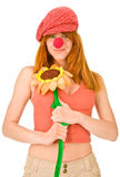 Smiling clown girl. With colorful flower isolated on white Royalty Free Stock Photos