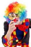 Clown with magnifying glass Stock Image
