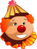 Smiling clown in a red hat. Positive emotions of the smiling circus red-haired clown with a red nose Royalty Free Stock Photo