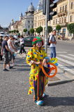 Smiling clown on the street. Royalty Free Stock Photography