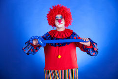 Smiling clown in studio with balloon Stock Photography