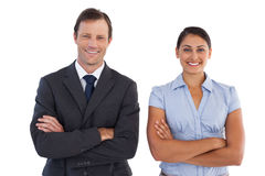 Smiling co workers standing next to each other Royalty Free Stock Photography