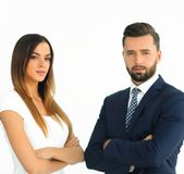A business man and woman with their hands crossed. Smiling co workers standing next to each other on white background Stock Images