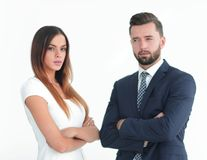 A business man and woman with their hands crossed. Smiling co workers standing next to each other on white background Stock Photo