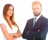 A business man and woman with their hands crossed. Smiling co workers standing next to each other on white background Stock Image