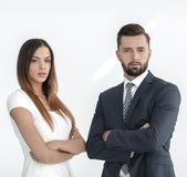 A business man and woman with their hands crossed. Smiling co workers standing next to each other on white background Royalty Free Stock Photo