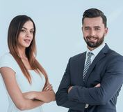 A business man and woman with their hands crossed. Smiling co workers standing next to each other on white background Royalty Free Stock Photography