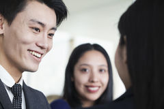 Smiling Co-workers talking in office Royalty Free Stock Photo