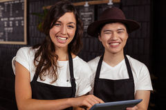 Smiling co-workers using tablet Stock Photos