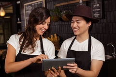 Smiling co-workers using tablet Royalty Free Stock Images