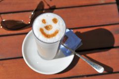 Smiling coffee stock image