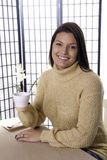 Smiling with coffee cup. Royalty Free Stock Images