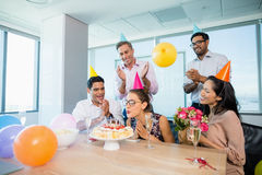 Smiling colleagues celebrating birthday of woman Royalty Free Stock Photo