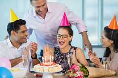 Smiling colleagues celebrating birthday of woman Royalty Free Stock Image