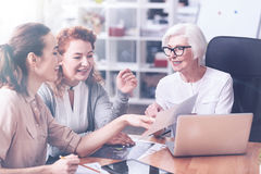 Smiling colleagues discussing actively some points Stock Image