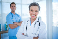 Smiling colleagues doctors looking at the camera Royalty Free Stock Image