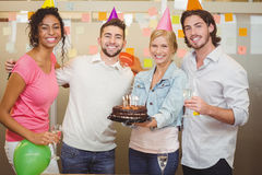 Smiling colleagues enjoying birthday party Stock Image
