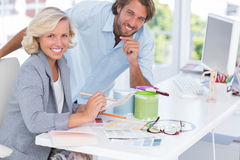 Smiling colleagues of interior design working together Royalty Free Stock Photos