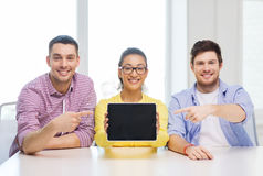 Smiling colleagues showing tablet pc blank screen Royalty Free Stock Photos