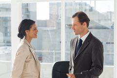 Smiling colleagues speaking together Royalty Free Stock Image