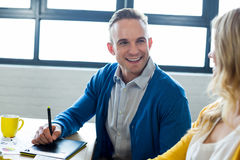 Smiling colleagues talking in office royalty free stock photography