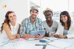 Smiling colleagues using digital tablet Royalty Free Stock Photo