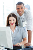 Smiling colleagues working together stock photo