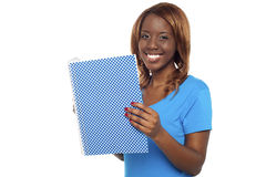 Smiling college student holding notebook Royalty Free Stock Photography