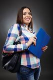 Smiling college student holding a notebook Royalty Free Stock Photos