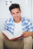 Smiling college student holding notebook. At the college Royalty Free Stock Photo