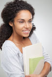 Smiling College Student Holding Notebooks Royalty Free Stock Image