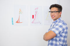 Smiling college student posing with arms crossed. At college Stock Image