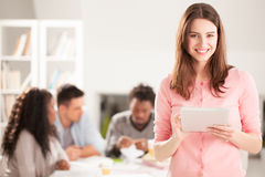 Smiling College Student With a Tablet Stock Images