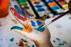 Smiling colorful children hands. Closeup Royalty Free Stock Photography