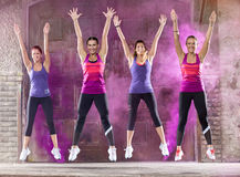 Smiling colorful girls dance outside Royalty Free Stock Images
