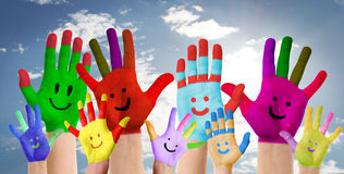 smiling colorful hands raised up Royalty Free Stock Photography