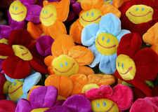 Smiling colourful flowers. A bunch of funny and smiling happy artificial flowers, made of fabric, in different colours Royalty Free Stock Photo