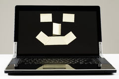 Smiling computer Stock Images