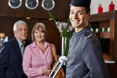 Smiling concierge with senior couple Stock Images