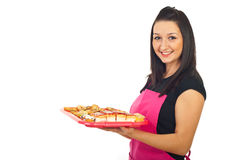 Smiling confectioner woman holding cookies Royalty Free Stock Photography