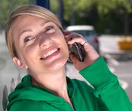 Smiling,confident blond woman on mobile phone Royalty Free Stock Image