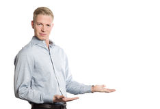 Friendly businessman showing empty space for text. Royalty Free Stock Photo