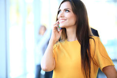 Smiling confident business woman having a phone call Stock Photo