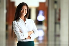 Smiling confident business woman looking at camera royalty free stock photo