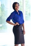 Smiling confident business woman standing outdoors Stock Photo