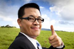 Smiling and confident businessman Stock Photos