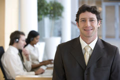 Smiling and confident businessman stock photography