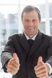 Smiling confident businessman giving thumbs up Royalty Free Stock Image