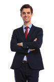 Smiling confident businessman standing with arms folded Stock Photo