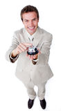 Smiling confident businessman using a service bell. Isolated on a white background Royalty Free Stock Photos